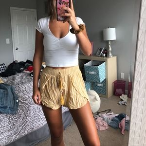 yellow and white flowy american eagle shorts